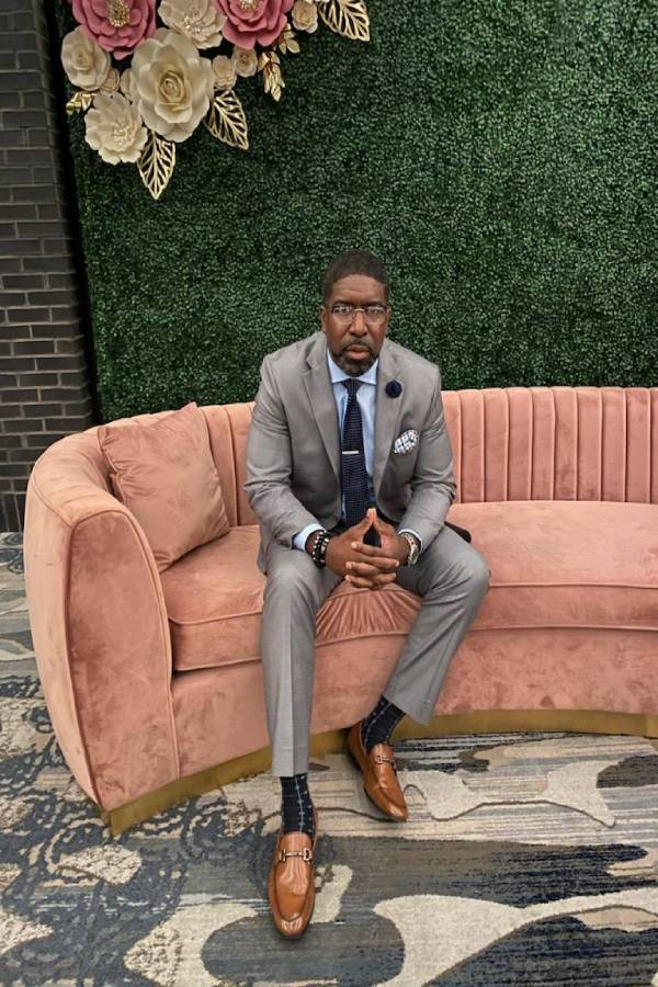 CB-sitting_brown suit_couch